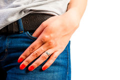 Pocket of jeans and a female hand Stock Image