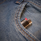 The pocket of jeans with lighter. Cloth background Royalty Free Stock Photo