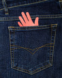 The pocket of jeans and the palm of paper Royalty Free Stock Photo