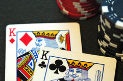 Pocket Kings. Two Kings on a poker table with stacks of chips Royalty Free Stock Images