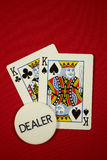 Pocket kings on the button. Poker hand, pocket kings on the button, on red felt Royalty Free Stock Photo