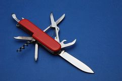 Pocket knife. On blue background from above Stock Images