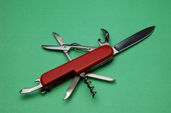 Pocket knife. On green background from above Stock Photography