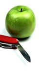 Pocket knife and apple Stock Photography