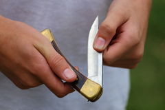 Pocket Knife. Close up view of someone opening or closing a pocket knife Royalty Free Stock Image