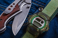 Pocket knife and electronic watches Royalty Free Stock Photo