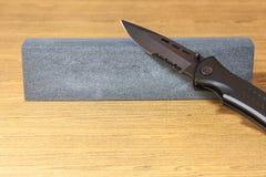Pocket knife and hone Royalty Free Stock Photos