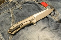 Pocket knife. The reverse side of the knife. View from above. Warm mood. stock photo