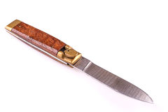 Pocket knife with wood handle isolated over white Royalty Free Stock Images