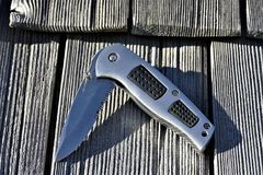 Pocket knife on wooden shingles
