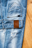 Pocket and label of ripped jeans Royalty Free Stock Photography