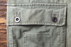 Pocket of linen pants background. Background pocket of men`s pants made of natural fabric on a wooden background. Horizontal photo Royalty Free Stock Images