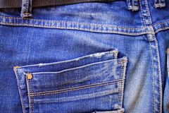 Pocket on unisex jeans trousers behind. Pocket on male or female blue jeanse texile trousers behind indigo color Royalty Free Stock Images