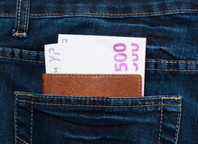 Pocket money. In the elegant blue jeans and passport Royalty Free Stock Photography