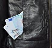 Pocket money. Eur money falling out of pocket of leather jacket Stock Photo