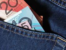 Pocket Money. Australian money in jeans pocket stock image