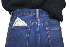 Pocket money. Money in a back pocket of jeans Stock Image