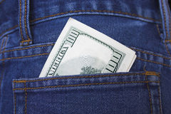 Pocket money. Money in a back pocket of jeans Royalty Free Stock Images