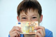 Pocket money. Happy teenager boy, he gets more pocket money Stock Photo