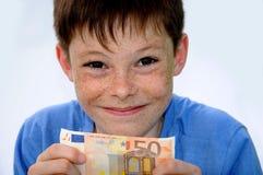 Pocket money. Happy teenager boy, he gets more pocket money Royalty Free Stock Photos