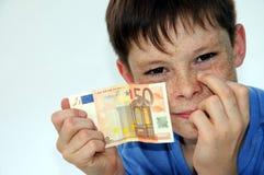 Pocket money. Happy teenager boy, he gets more pocket money Stock Photography