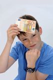 Pocket money. Happy teenager boy, he gets more pocket money Royalty Free Stock Images