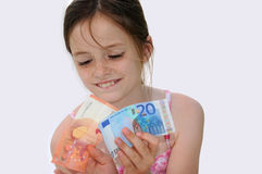 Pocket money. Happy teenager girl, she gets more pocket money Stock Photography