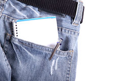 Pocket notes. A notebook in some jeans trousers Stock Image