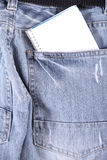 Pocket notes. A notebook in some jeans trousers Royalty Free Stock Image
