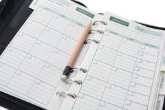 Pocket Organizer and Pencil Royalty Free Stock Photo