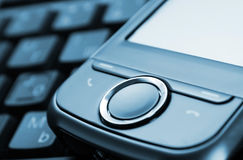 Pocket PC. Pda with keyboard on the background Royalty Free Stock Image