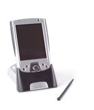 Pocket PC Life. Pocket PC in cradle with stylus over white background Stock Image
