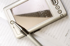 Pocket PC and pen Royalty Free Stock Photos