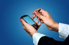 Pocket pc on woman hands Stock Photography