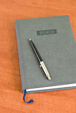 Pocket planner and pen Stock Images