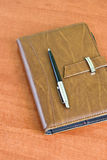 Pocket planner and pen Royalty Free Stock Image