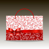 Pocket shopping bag red and white pattern with bow Stock Photos