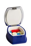 Pocket tablet box with tablet and capsules. Isolated over white Stock Image