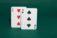 Pocket threes. Closeup of pocket threes starting hand in hold'em poker also called crabs in horizontal view Royalty Free Stock Image