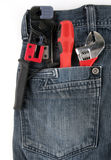 Pocket tools. Blue jeans trousers repair tools Royalty Free Stock Photo