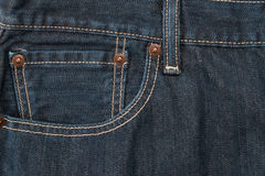 Pocket and waistband of denim blue jeans as a background Royalty Free Stock Photos