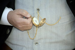 Pocket watch. The hands of the old person looking at the pocket watch Stock Images