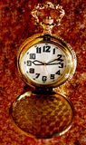 Pocket watch. Golden pocket watch over grunge background Royalty Free Stock Photo