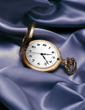 Pocket Watch. Gold pocket watch on silver silk Royalty Free Stock Photos