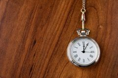 Pocket watch. Old pocket watch on dark brown table Royalty Free Stock Photo