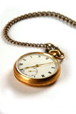 Pocket Watch. A gold vintage pocket watch isolated on a white background Stock Photos