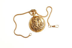 Pocket watch. An antique gold pocket watch with chain and wonderful engraving on the Stock Images