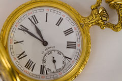 Pocket watch. Half hunter pocket watch showing five minutes to midnight Royalty Free Stock Photo