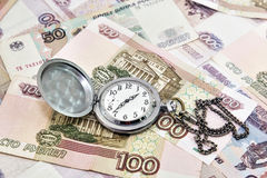 Pocket watch against the background of Russian money Royalty Free Stock Image