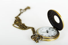 Pocket watch against a light background Royalty Free Stock Photography